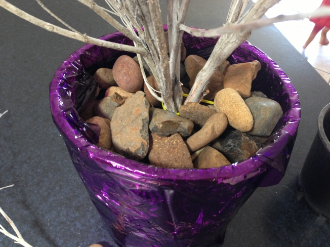 Filled the pot with rocks to secure the branches and to stop it tipping over.