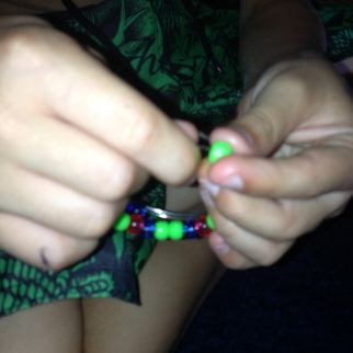 Mr 7 threading some beads.