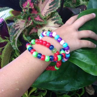 Ms 4 modelling some bracelets.