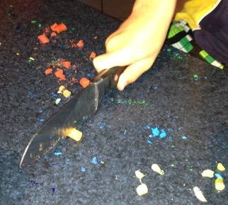 Mr 8. Cutting the crayons into smaller pieces.