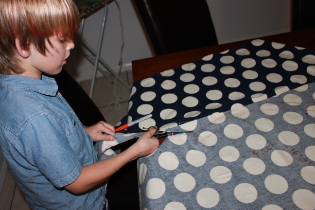 Mr 8 helping cut out the outer layer
