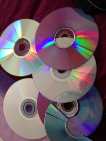 Gather your old CDs, DVDs the more different colours the better.