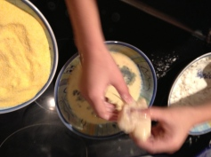 Dipping in milk and egg mixture