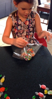 Ms4 bundling up the lollies ready for string and tag.