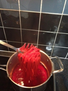 Add colouring, then pasta, cook as normal or a little less for firmer pasta