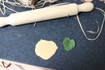 Roll over bake clay out to desired thickness. Press leaf into clay and roll again. Remove leaf and cut out leaf shape