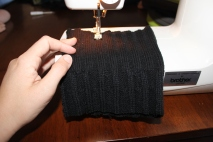 Sewing a piece out of the jumper to form a sleeve shape