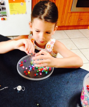 Ms4 filling up her 'rainbow' bauble