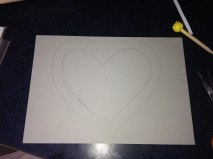 I drew a large heart on the back of some silver card then cut it out with scissors.