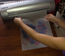 Ms5 puts the close sheet into the laminator.