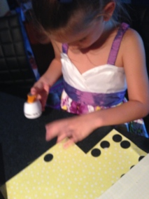 """Ms5 cutting out the paper circles using a 1"""" punch."""