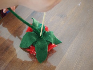 Wrap skewer with pipe cleaner for colour and texture, or you could just use a green skewer.