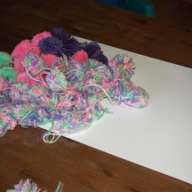 Card and hand made pom poms