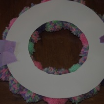 Attach some ribbon to the back for decoration and to hang wreath