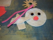 Create a bunny face from pipe cleaners and felt.