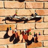 Beaded sun catcher with clay discs.